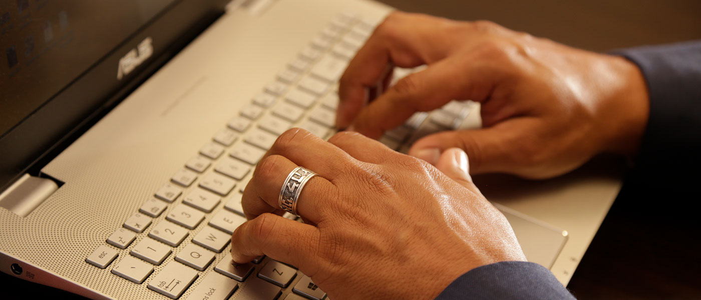 Close up of hands typing on a keyboard